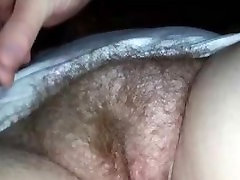 Fingering a hairy mature muff - closeup