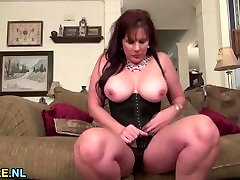 Huge titted mature brunette using a massive dildo