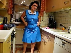 mature sexy bbw from DesireBBWs.com trying on aprons