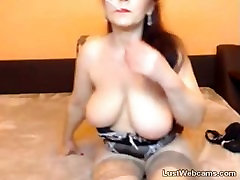 Hot mature masturbates with dildo while smoking on webcam