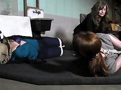 Two girls hogtied in boots