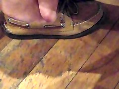 Asian girl wiggling feet and toes in coffee house