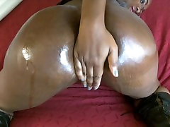 Doll oils and shakes her big juicy booty
