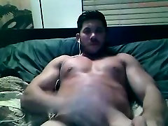 tan muscle hunk cums