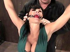 Enslaved milf Lisa Ann gets her massive tits and hairless pussy punished