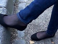 Shoeplay in black pantyhose under jeans