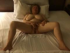 Busty mature lady having an orgasm