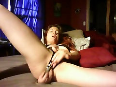 Horny slut toys pussy in open crotch panties