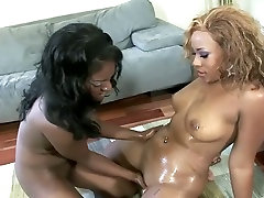 Two busty ebony bimbos on the couch eating out each other