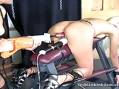 Steamy blond chic gets her gaped pussy drilled with dildo in BDSM-sex clip