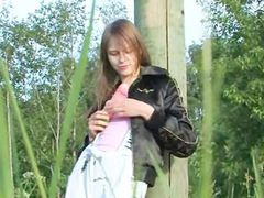 breasty teen dildoing cunt in the grass