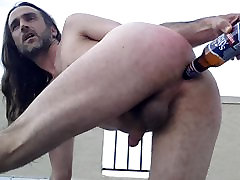 gringo slut spanking and fingering his ass on top of hotel 4