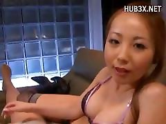 Sweet little Asian MILF gives him a hot POV handjob and licks his cum