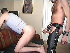 Fucking a boy bareback in leather chaps