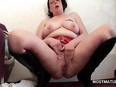Lusty mature masturbates and cums hard