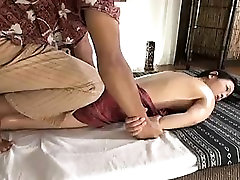 Busty Asian babe gets a nice massage and then some boob gro