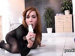Exquisite sweetie is peeing and pleasuring shaven vagina