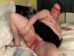 Mature BBW in glasses gets double toy fucked