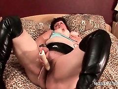 Mature BBW fucks herself with large dildo