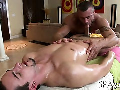 Cute homosexual chap is given a spooning during massage