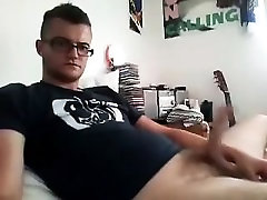 Handsome male is relaxing in a small room and memorializing