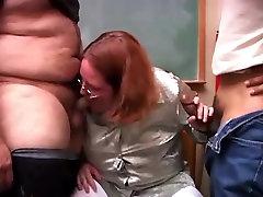 Chubby Redhead Sucking Two Cocks