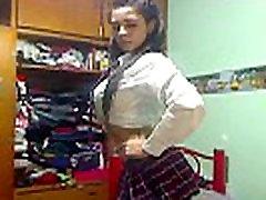 Big tits &amp ass Latin schoolgirl striptease out of her uniform
