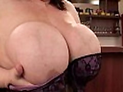 Mature BBW anne marie with XXL tits wears stockings and high heels