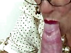 Mature mistress tugs cock