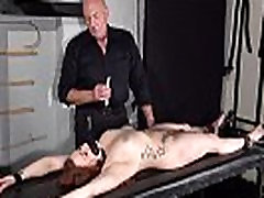 Amateur slave Louise in dungeon rack bondage and hot wax tit punishments