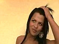 Foxy brunette tranny babe tugging on her hard cock