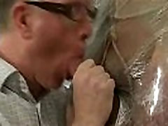 Saran wrapped hunk getting his hard cock sucked on