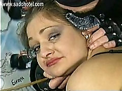 Masked master puts large metal needles in ass of crying slave with big tits sitting on a motorcycle