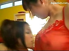 2 Asian Girls In Nighties Kissing Spitting Sucking Nipples Patting On The Bed