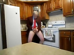Daddy jacking in the kitchen in costume and tie