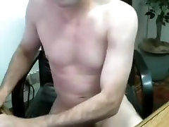 Nice male is masturbating in the apartment and memorializing himself on computer webcam