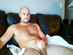 Attractive male is playing in his room and memorializing himself on computer webcam