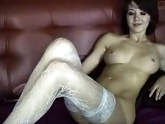 Webcam brunette fingers her pussy and teases