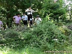 german lederhosen gangbang in nature