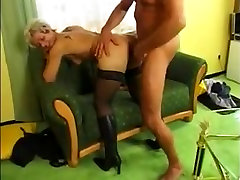 Short haired blond German MILF in stockings and boots fucked