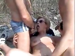 Mature bitch gets face fucked on the beach