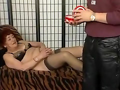 Hairy granny plays with her fat dildo