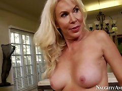 Lustful mature porn actress Erica Lauren is fucking furiously in a spicy porn clip