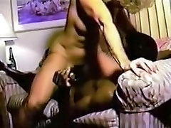 Mature woman and her black bull in a hotel room