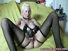 Pierced granny with chains to her pierced fur pie lips