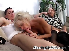 Mature busty wife sucks off a young guy
