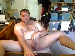 Handsome man is beating off in his room and shooting himself on camera
