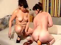 Horny mature lesbians with toys and fist