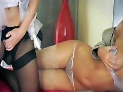 Two hot hot lesbians using strap