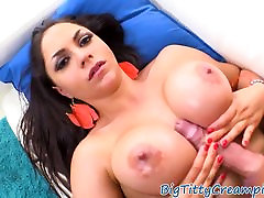 Busty latina tittyfucked on her back